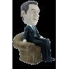 Figurine personnalisée dans une fauteuil